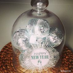 New Year's Eve decor idea - disco balls under cloche