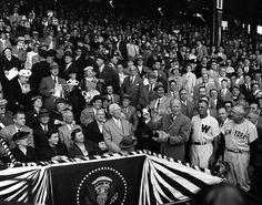 President Eisenhower throws out the first ball at a game between the New York Yankees and the Washington Senators at Griffith Stadium in Was...