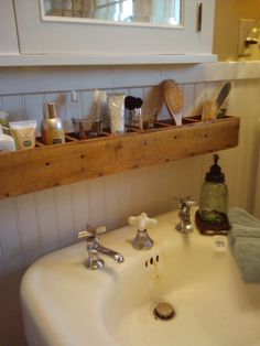 CD tower turned on its side and used for storage - brilliant! Reduce reuse repurpose! Love this for over the sink .. what a great use of space!