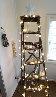 A Christmas ladder with coastal decorations.