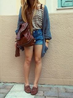 striped shirt and over the shoulder bag.
