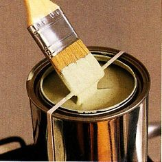 Place a rubber band around the open can so you can wipe the excess paint off the brush and not the side of the can every time you dip.