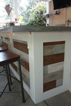 Outdoor bar...like the wood slats and concrete counters