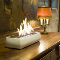 tabletop fireplace...must have! Ones on walls?