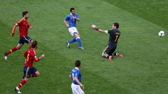 Antonio Di Natale of Italy scores their first goal past Iker Casillas (R) of Spain during their UEFA EURO 2012 Group C match