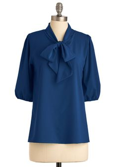 I'm a sucker for a tie-neck blouse.  Love the shade of blue as well.