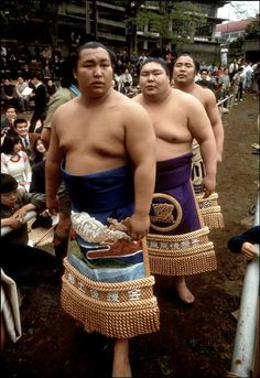Sumo wrestlers in their pre-match regalia prior to a bout, Honshu, 1972 by Ian Berry