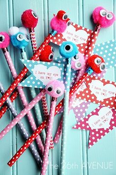 DIY Valentine Monster Pencils.  (Free printable at link.)  These look cute, easy, and inexpensive!