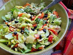Mexican Fiesta Salad    This festive salad is a perfect side to any Mexican meal. The black beans, corn, and salsa give it a real Mexican flair. It is great served with a little extra salsa or taco sauce on the side.