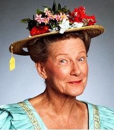 Minnie Pearl from Hee-Haw...I loved that show!!  And I was beyond excited and privelaged to see her at the Grand Ole Opry