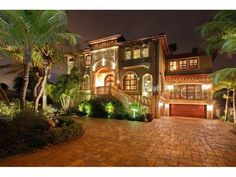 This home's exterior lighting gives off a very dramatic effect. St. Pete Beach, FL Coldwell Banker Residential Real Estate