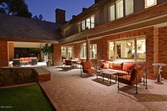 A very large backyard patio that extends the entire length of the home.