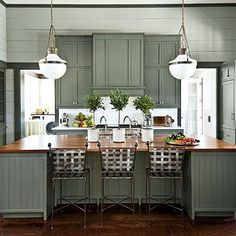 The Kitchen | From cabinet countertop configuration to hanging pendants, the two sides of this kitchen are almost exact matches. At each end, the elements differ, but their size and scale balance each other to feel symmetrical. | #SLIdeaHouse | SouthernLiving.com