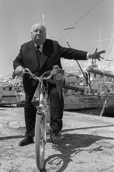 Alfred Hitchcock on a bicycle