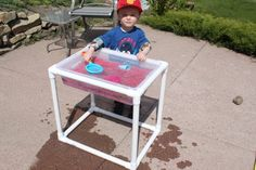 pvc sensory table...good idea for a sand and water table...I would add a cover or umbrella