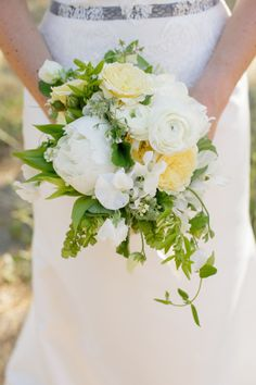White bouquet with yellow accents: http://www.stylemepretty.com/2014/09/19/solage-calistoga-wedding-awash-with-yellow/   Photography: Weddings by Sasha - http://weddingsbysasha.com/