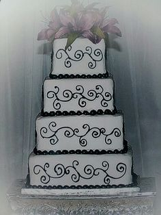 Black, white and purple wedding cake.