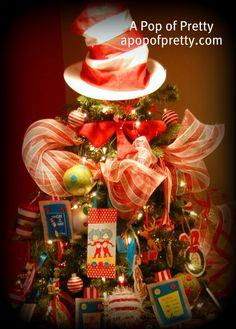 A fun and whimsical Dr. Seuss Christmas tree with mostly handmade decorations!  My favorite part? The Dr. Seuss Hat and Bow-Tie for the tree topper! tis-the-season-to-be-jolly