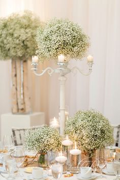 Candles & baby's breath tall centerpieces.