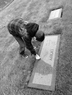 My son touching his great grandparents grave.