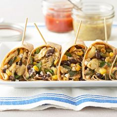 With protein-filled black beans plus corn, these Breakfast Burritos make a delicious meal. More easy breakfast recipes: http://www.bhg.com/recipes/breakfast/easy/easy-breakfast-recipes #myplate #protein