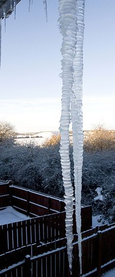 Montana Icicles... mass of freezing ice that glows and grows underneath a Montana Sky
