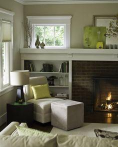 i like the fireplace, bookshelf, window arrangement