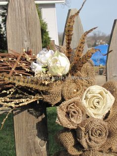 #Burlap rose and #feather details on #grapevine #wreath  www.facebook.com/wreathswithareason