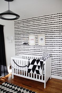 Modern Black and White Nursery with fab wallpaper accent wall