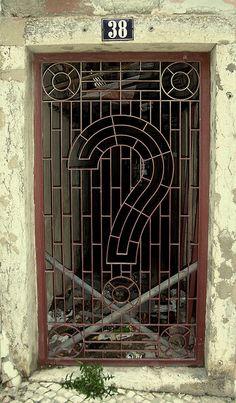 """Wrought Iron """"Question mark"""" Door."""