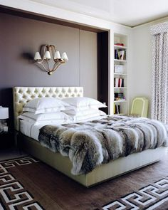 bedrooms - Greek key floor design ivory tufted leather bed faux fur blanket chocolate brown accent wall bedroom Chic city bedroom design with