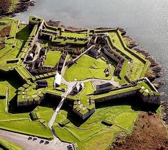 "Kinsale's ""Charles Fort"" was one of the most extensive star-forts built to defend the ""realm"" from the threat of Spanish invasion. By unknown author. Repinned by WI/IE. _____________________________Do feel free to visit us on http://www.wonderfulireland.ie/south/kinsale/#/ for lots more pictures and stories of beautiful Ireland."