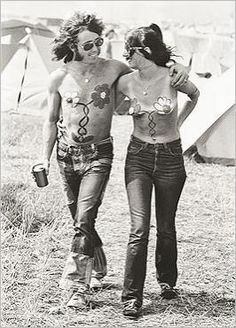 1969 Isle of Wight festival painted hippy couple take a stroll...