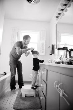 Must remember to take a picture like this someday. Daddy fixing his little girl's hair. :)