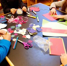 Some of our donations from scrapbookers being transformed into winter crafts.