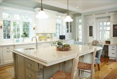 Pretty kitchen cabinet color... nice finished edge on counters