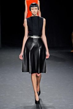 A black leather skirt, for instance, flared while metallic belts cinched nearly every look at Calvin Klein F/W 2012