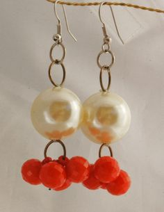 Fun  Oversized Lucite Pearl / Coral Dangle Earrings / Hand Crafted One of Kind .  Stunning  unique  hand crafted earrings made from vintage beads and components.        	They are an original creation...