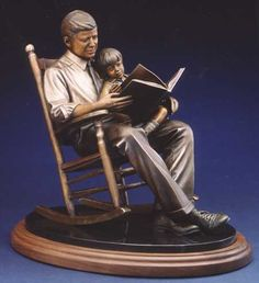 'Turning the Pages' - bronze statue by Lundeen Bronzes