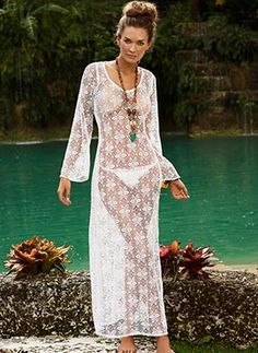 Long dress in a white crochet flower pattern with long sleeves. Dress ties at the back of the neck with a large wide opening by PilyQ Swimwear, $174.00