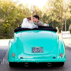A friend of the groom's father owns a 1939 Ford convertible that matched the wedding colors -- perfect for the couple's exit from the church!