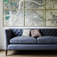 Living room with framed maps