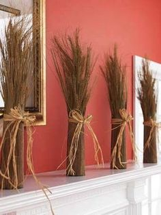 Cinnamon broom broken into different vases as a mantle or table top decoration.