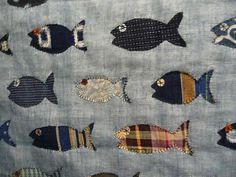 Vintage quilt with sampling of applique fish on loose cotton gauze ground. Blue and White Shop in Tokyo.