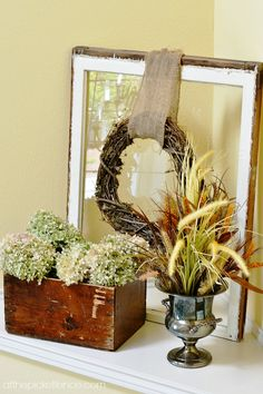Fall window pane with grapevine wreath, hydrangeas and wheat in silver urn vignette from atthepicketfence.com