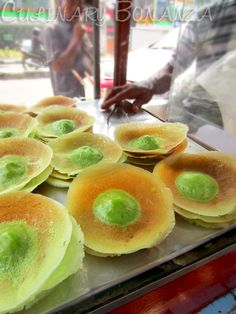 Kue ape, thin wheat flour batter pancake with thicker part on the middle, coloquially called kue tetek (breast cake).