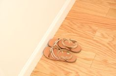 Sparkly gold dress sandals placed inside the new bedroom closet by one of our family partner's daughter.  BECOME A HOMEOWNER!