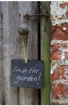 In the garden chalkboard sign