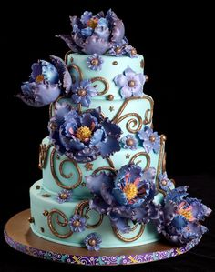 """Purple Elegance""  wedding cake ~ All the flowers are made from gum paste and everything is edible"