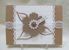 card from Savvy Handmade Cards: White on Kraft For You Card ... luv the layered flower ... great leaves ... wide ivory band  down the middle with embossing and border punched ... great card! ... Stampin'Up!